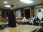 Fr. John discusses the activities for the retreat.