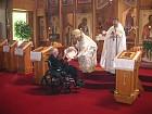 Bishop Nikon presents Gramata to Protodeacon Simeon