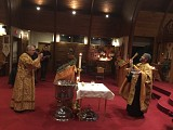 Fr. John and Deacon Paul blessing the nave of the Church with the newly blessed Holy Water